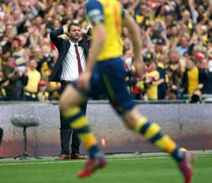 30 May 2015 FA Cup Final - Arsenal v Aston Villa ;  dejection for Villa manager Tim Sherwood as Mertesacker celebrates after the third Arsenal goal. Photo: Mark Leech.