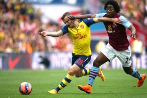 30 May 2015 FA Cup Final - Arsenal v Aston Villa ;  Jack Wilshere of Arsenal is grabbed by Carlos Sanchez of Villa.Photo: Mark Leech.