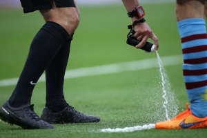 30 May 2015 FA Cup Final - Arsenal v Aston Villa ;  referee Jon Moss uses his can of vanishing spray. Photo: Mark Leech.