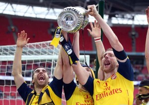30 May 2015 FA Cup Final - Arsenal v Aston Villa ; Per Mertesacker lifts the FA Cup for Arsenal.  Photo: Mark Leech.