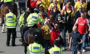 30 May 2015 FA Cup Final - Arsenal v Aston Villa ;  Arsenal supporters and police on Wembley Way. Photo: Mark Leech.