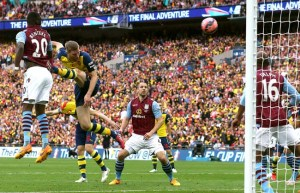 30 May 2015 FA Cup Final - Arsenal v Aston Villa ;  Per Mertesacker heads the third goal for Arsenal. Photo: Mark Leech.