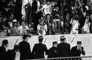 28/05/1975 Paris.  European Cup Final. Bayern Munich v Leeds United. A Gendarme looks confused as a Leeds fan gives the French the finger.
